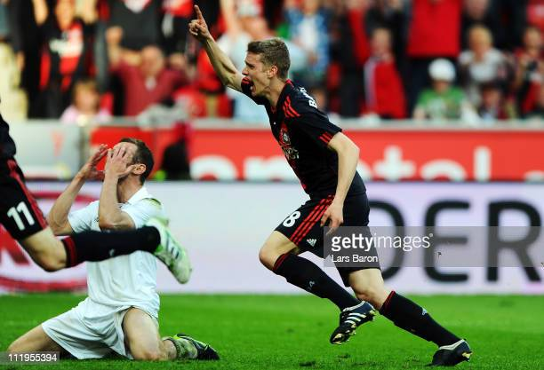 Lars Bender of Leverkusen celebrates scoring his teams second goal next to Markus Thorandt of Pauli during the Bundesliga match between Bayer...