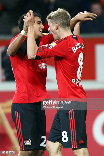 Lars Bender of Leverkusen celebrates the fourth goal with team mate Arturo Vidal during the Bundesliga match between Bayer Leverkusen and Eintracht...