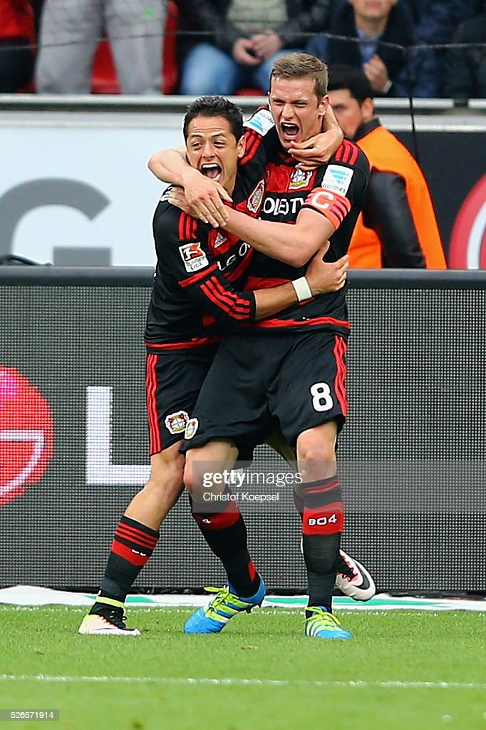 Lars Bender of Leverkusen (R) celebrates the second goal with Charles Aranguiz of Leverkusen (L) during the Bundesliga match between Bayer Leverkusen and Hertha BSC Berlin at BayArena on April 30, 2016 in Leverkusen, Germany.