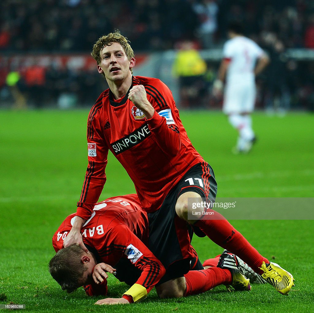 Lars Bender of Leverkusen celebrates with team mate Stefan Kiessling after scoring his teams winning goal during the Bundesliga match between Bayer...