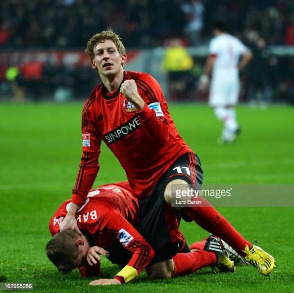 Lars Bender of Leverkusen celebrates with team mate Stefan Kiessling after scoring his teams winning goal during the Bundesliga match between Bayer...
