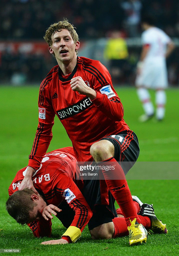<a gi-track='captionPersonalityLinkClicked' href=/galleries/search?phrase=Lars+Bender&family=editorial&specificpeople=644948 ng-click='$event.stopPropagation()'>Lars Bender</a> of Leverkusen celebrates with team mate <a gi-track='captionPersonalityLinkClicked' href=/galleries/search?phrase=Stefan+Kiessling&family=editorial&specificpeople=605405 ng-click='$event.stopPropagation()'>Stefan Kiessling</a> after scoring his teams winning goal during the Bundesliga match between Bayer 04 Leverkusen and VfB Stuttgart at BayArena on March 2, 2013 in Leverkusen, Germany.