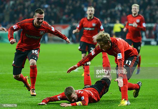 Lars Bender of Leverkusen celebrates with team mates after scoring his teams winning goal during the Bundesliga match between Bayer 04 Leverkusen and...