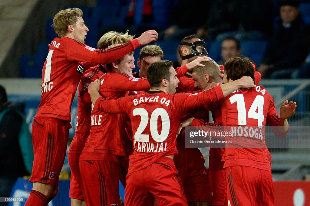 <a gi-track='captionPersonalityLinkClicked' href=/galleries/search?phrase=Lars+Bender&family=editorial&specificpeople=644948 ng-click='$event.stopPropagation()'>Lars Bender</a> of Leverkusen celebrates with teammates after scoring his team's first goal during the Bundesliga match between TSG 1899 Hoffenheim and Bayer 04 Leverkusen at Rhein-Neckar-Arena on November 25, 2012 in Sinsheim, Germany.