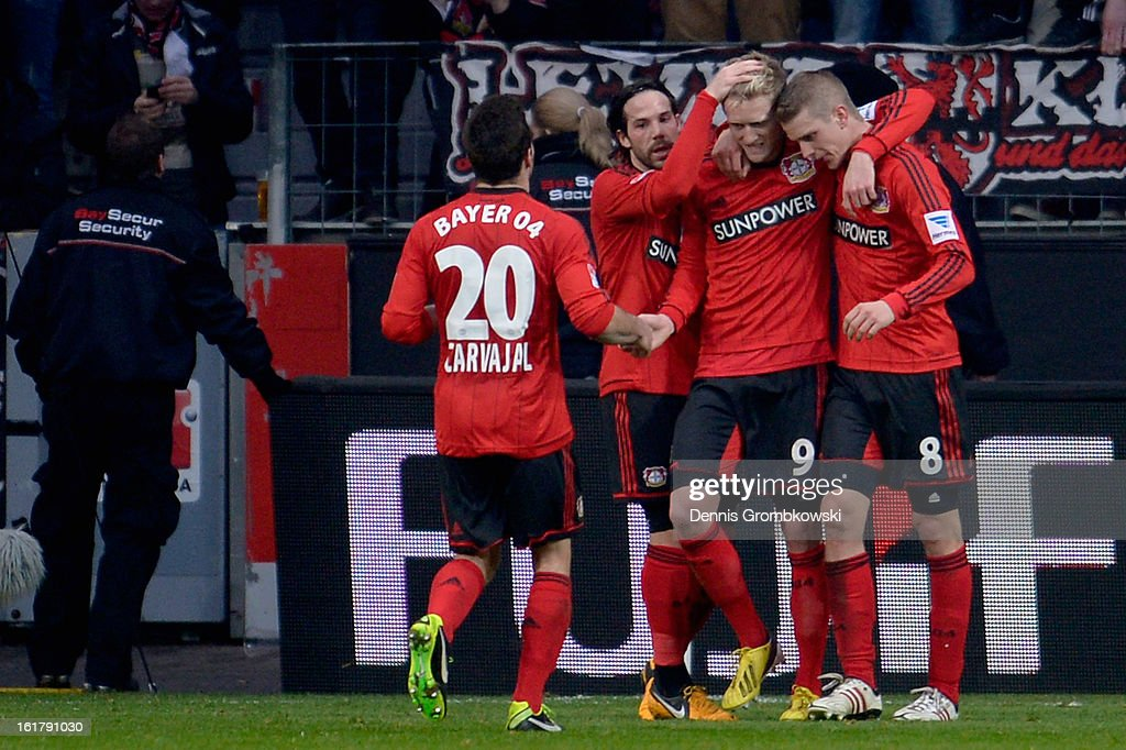 <a gi-track='captionPersonalityLinkClicked' href=/galleries/search?phrase=Lars+Bender&family=editorial&specificpeople=644948 ng-click='$event.stopPropagation()'>Lars Bender</a> of Leverkusen celebrates with teammates after scoring his team's second goal during the Bundesliga match between Bayer 04 Leverkusen and FC Augsburg at BayArena on February 16, 2013 in Leverkusen, Germany.