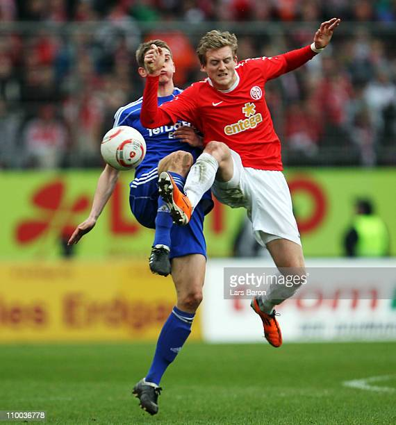 Lars Bender of Leverkusen challenges Andre Schuerrle of Mainz during the Bundesliga match between FSV Mainz 05 and Bayer Leverkusen at Bruchweg...