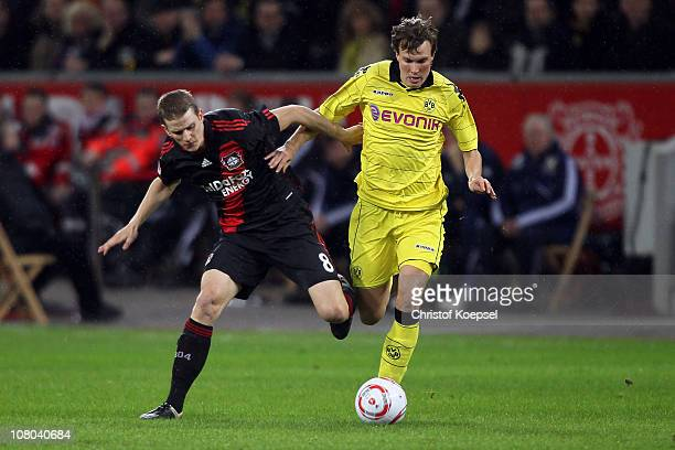 Lars Bender of Leverkusen challenges Kevin Grosskreutz of Dortmund during the Bundesliga match between Bayer Leverkusen and Borussia Dortmund at...