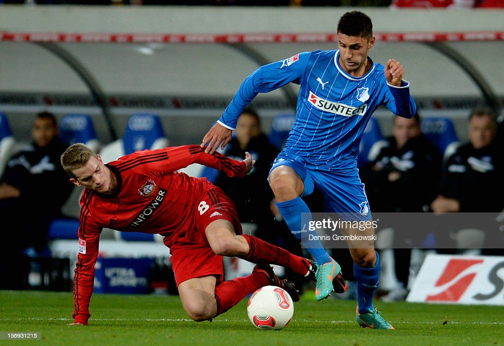 <a gi-track='captionPersonalityLinkClicked' href=/galleries/search?phrase=Lars+Bender&family=editorial&specificpeople=644948 ng-click='$event.stopPropagation()'>Lars Bender</a> of Leverkusen challenges Vincenzo Grifo of Hoffenheim during the Bundesliga match between TSG 1899 Hoffenheim and Bayer 04 Leverkusen at Rhein-Neckar-Arena on November 25, 2012 in Sinsheim, Germany.
