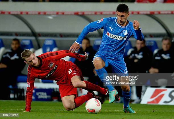 Lars Bender of Leverkusen challenges Vincenzo Grifo of Hoffenheim during the Bundesliga match between TSG 1899 Hoffenheim and Bayer 04 Leverkusen at...