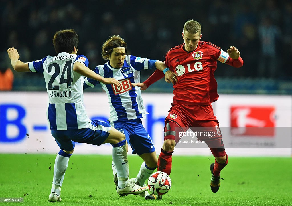 <a gi-track='captionPersonalityLinkClicked' href=/galleries/search?phrase=Lars+Bender&family=editorial&specificpeople=644948 ng-click='$event.stopPropagation()'>Lars Bender</a> of Leverkusen is challenged by <a gi-track='captionPersonalityLinkClicked' href=/galleries/search?phrase=Hajime+Hosogai&family=editorial&specificpeople=4023693 ng-click='$event.stopPropagation()'>Hajime Hosogai</a> and <a gi-track='captionPersonalityLinkClicked' href=/galleries/search?phrase=Genki+Haraguchi&family=editorial&specificpeople=5473188 ng-click='$event.stopPropagation()'>Genki Haraguchi</a> of Berlin during the Bundesliga match between Hertha BSC and Bayer 04 Leverkusen at Olympiastadion on February 4, 2015 in Berlin, Germany.