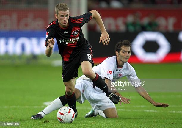 Lars Bender of Leverkusen is challenged by Halil Altintop of Frankfurt during the Bundesliga match between Bayer Leverkusen and Eintracht Frankfurt...