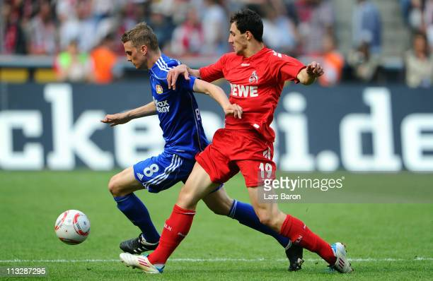 Lars Bender of Leverkusen is challenged by Mato Jajalo of Koeln during the Bundesliga match between 1 FC Koeln and Bayer Leverkusen at...