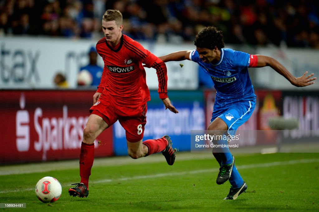 <a gi-track='captionPersonalityLinkClicked' href=/galleries/search?phrase=Lars+Bender&family=editorial&specificpeople=644948 ng-click='$event.stopPropagation()'>Lars Bender</a> of Leverkusen is chased by <a gi-track='captionPersonalityLinkClicked' href=/galleries/search?phrase=Marvin+Compper&family=editorial&specificpeople=739239 ng-click='$event.stopPropagation()'>Marvin Compper</a> of Hoffenheim during the Bundesliga match between TSG 1899 Hoffenheim and Bayer 04 Leverkusen at Rhein-Neckar-Arena on November 25, 2012 in Sinsheim, Germany.