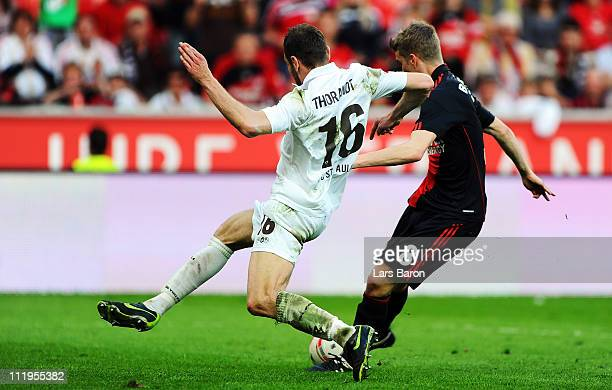 Lars Bender of Leverkusen scores his teams second goal past Markus Thorandt of Pauli during the Bundesliga match between Bayer Leverkusen and FC St...