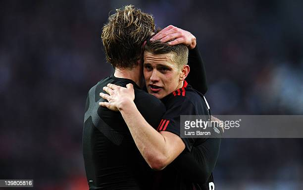 Lars Bender of Leverkusen who scored both goals celebrates with team mates after winning the Bundesliga match between 1 FC Koeln and Bayer 04...