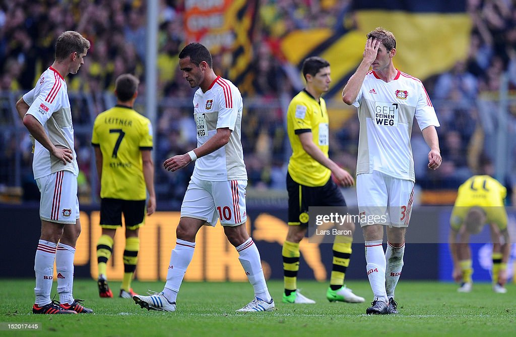 <a gi-track='captionPersonalityLinkClicked' href=/galleries/search?phrase=Lars+Bender&family=editorial&specificpeople=644948 ng-click='$event.stopPropagation()'>Lars Bender</a>, <a gi-track='captionPersonalityLinkClicked' href=/galleries/search?phrase=Renato+Augusto&family=editorial&specificpeople=4192762 ng-click='$event.stopPropagation()'>Renato Augusto</a> and <a gi-track='captionPersonalityLinkClicked' href=/galleries/search?phrase=Stefan+Reinartz&family=editorial&specificpeople=2244849 ng-click='$event.stopPropagation()'>Stefan Reinartz</a> of Leverkusen are looking dejected after loosing the Bundesliga match between Borussia Dortmund and Bayer 04 Leverkusen at Signal Iduna Park on September 15, 2012 in Dortmund, Germany.