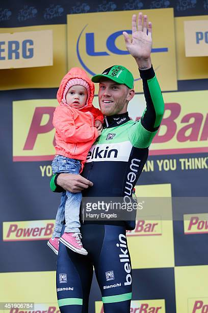 Lars Boom of the Netherlands and team Belkin Pro Cycling holds his daughter Kee after winning the fifth stage of the 2014 Tour de France a 155km...