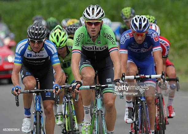 Lars Boom of The Netherlands and the Belkin Pro Cycling Team leads the breakaway on the Cote de Loucrup during the eighteenth stage of the 2014 Tour...