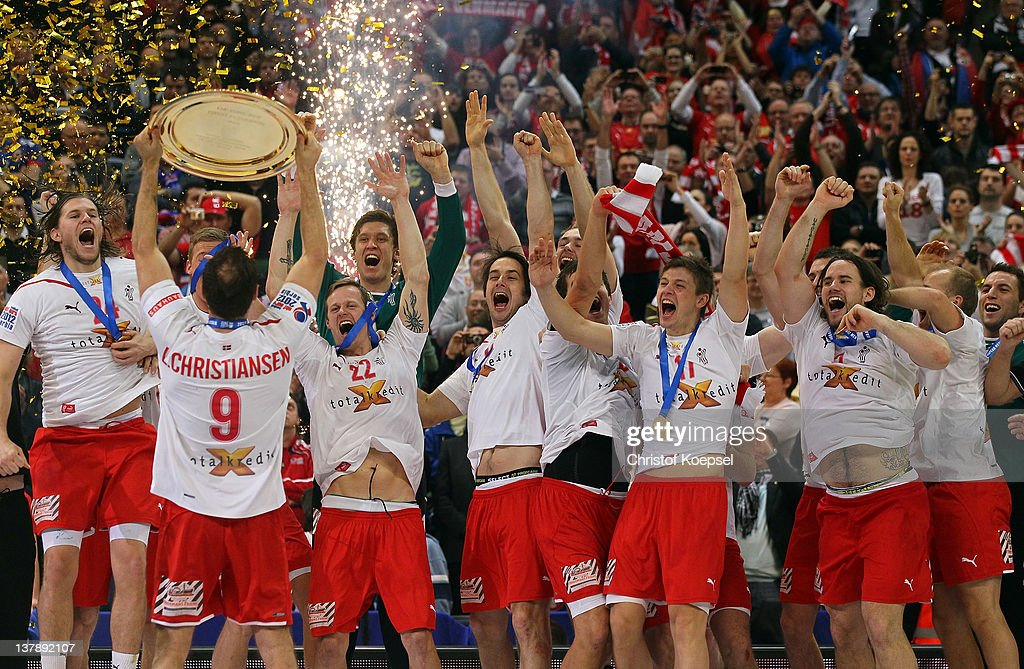 Lars Christiansen of Denmark (L) lifts the winning trophy to his team on the podium after winning 21-19 the Men's European Handball Championship final match between Serbia and Denmark at Beogradska Arena on January 29, 2012 in Belgrade, Serbia.