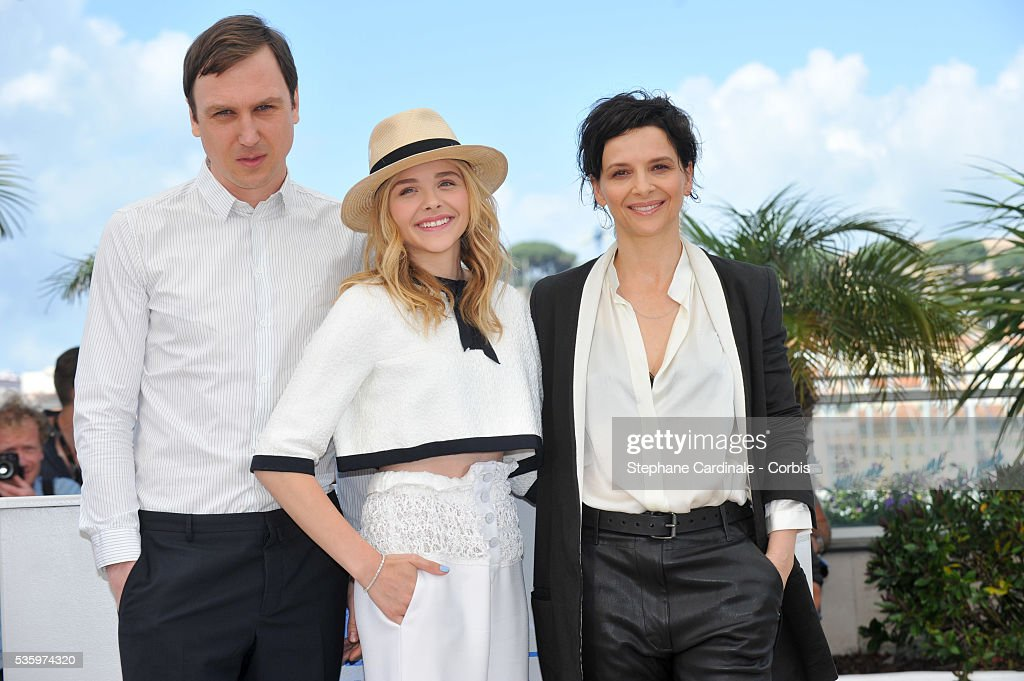 Lars Eidinger, Chloe Grace Moretz and Juliette Binoche attend the 'Clouds Of Sils Maria' photocall during the 67th Cannes Film Festival