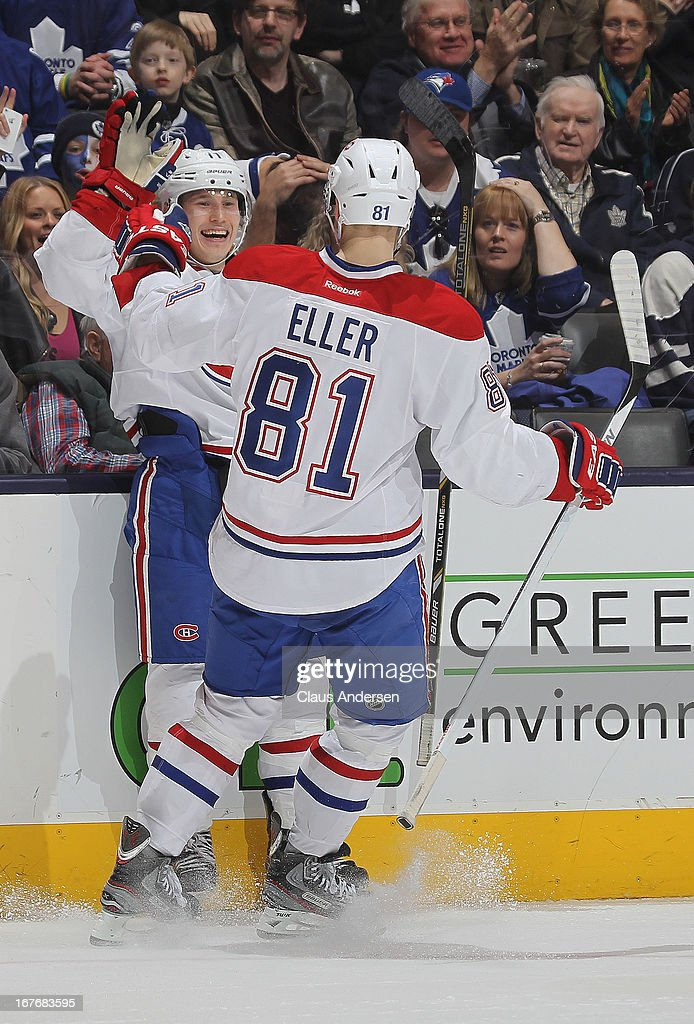 <a gi-track='captionPersonalityLinkClicked' href=/galleries/search?phrase=Lars+Eller&family=editorial&specificpeople=4324947 ng-click='$event.stopPropagation()'>Lars Eller</a> #81 and <a gi-track='captionPersonalityLinkClicked' href=/galleries/search?phrase=Brendan+Gallagher&family=editorial&specificpeople=3704208 ng-click='$event.stopPropagation()'>Brendan Gallagher</a> #11 of the Montreal Canadiens celebrate a goal in a game against the Toronto Maple Leafs on April 27, 2013 at the Air Canada Centre in Toronto, Ontario, Canada. The Canadiens defeated the Leafs 4-1.
