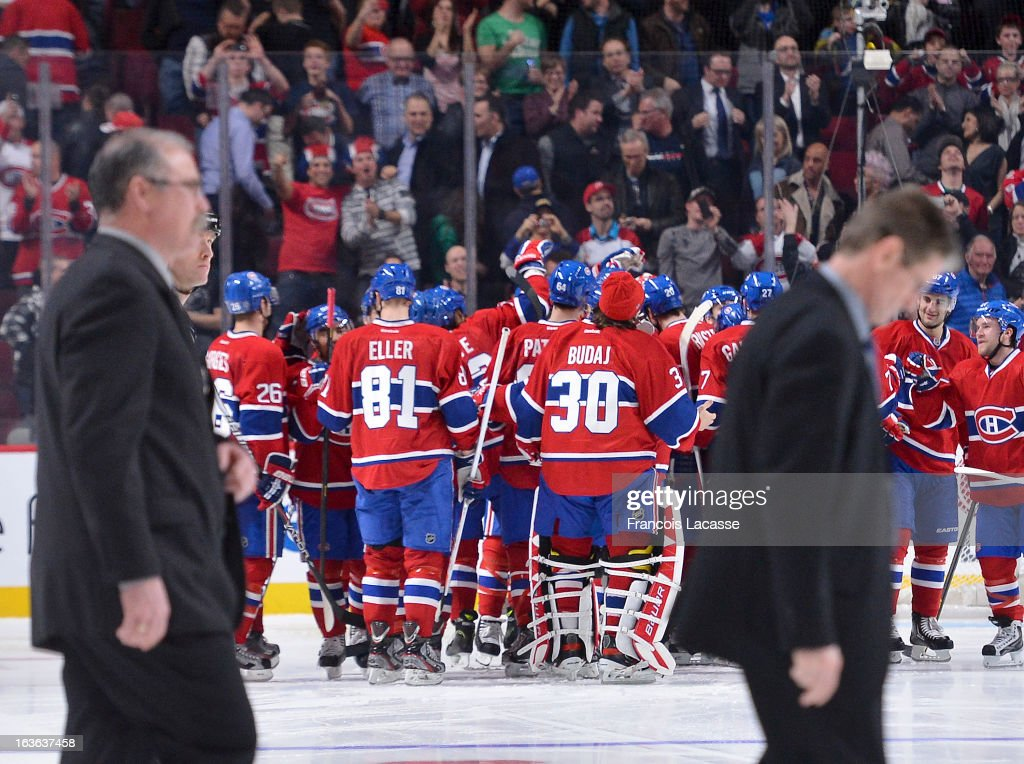 <a gi-track='captionPersonalityLinkClicked' href=/galleries/search?phrase=Lars+Eller&family=editorial&specificpeople=4324947 ng-click='$event.stopPropagation()'>Lars Eller</a> #81 and <a gi-track='captionPersonalityLinkClicked' href=/galleries/search?phrase=Peter+Budaj&family=editorial&specificpeople=228123 ng-click='$event.stopPropagation()'>Peter Budaj</a> #30 of the Montreal Canadiens celebrate a victory against the Ottawa Senators following the NHL game on March 13, 2013 at the Bell Centre in Montreal, Quebec, Canada.