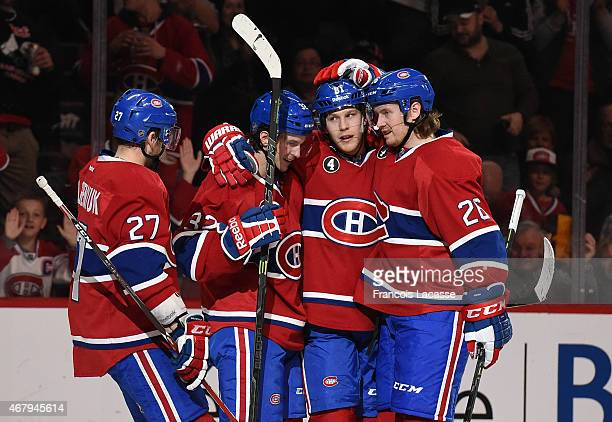 Lars Eller Jeff Petry Alex Galchenyuk and Brian Flynn of the Montreal Canadiens celebrate after scoring a goal against the Florida Panthers in the...