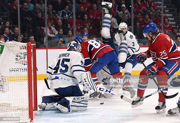 Lars Eller of the Montreal Canadiens and Korbinian Holzer of the Toronto Maple Leafs collides in the NHL game at the Bell Centre on February 28 2015...