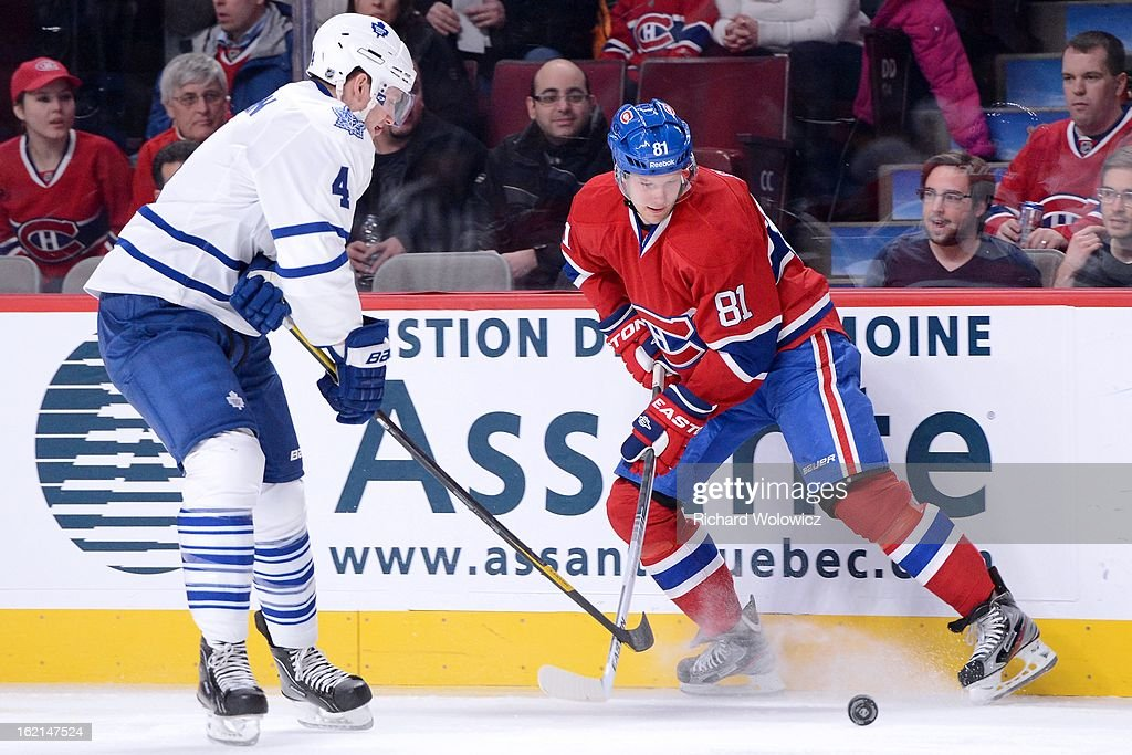 Lars Eller #81 of the Montreal Canadiens battles for the puck with Cody Franson #4 of the Toronto Maple Leafs during the NHL game at the Bell Centre on February 9, 2013 in Montreal, Quebec, Canada. The Maple Leafs defeated the Canadiens 6-0.