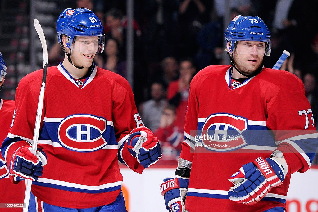 <a gi-track='captionPersonalityLinkClicked' href=/galleries/search?phrase=Lars+Eller&family=editorial&specificpeople=4324947 ng-click='$event.stopPropagation()'>Lars Eller</a> #81 of the Montreal Canadiens celebrates his second-period assist on a goal by Brian Gionta (not pictured) during the NHL game against the Winnipeg Jets at the Bell Centre on April 4, 2013 in Montreal, Quebec, Canada. The Canadiens defeated the Jets 4-1.