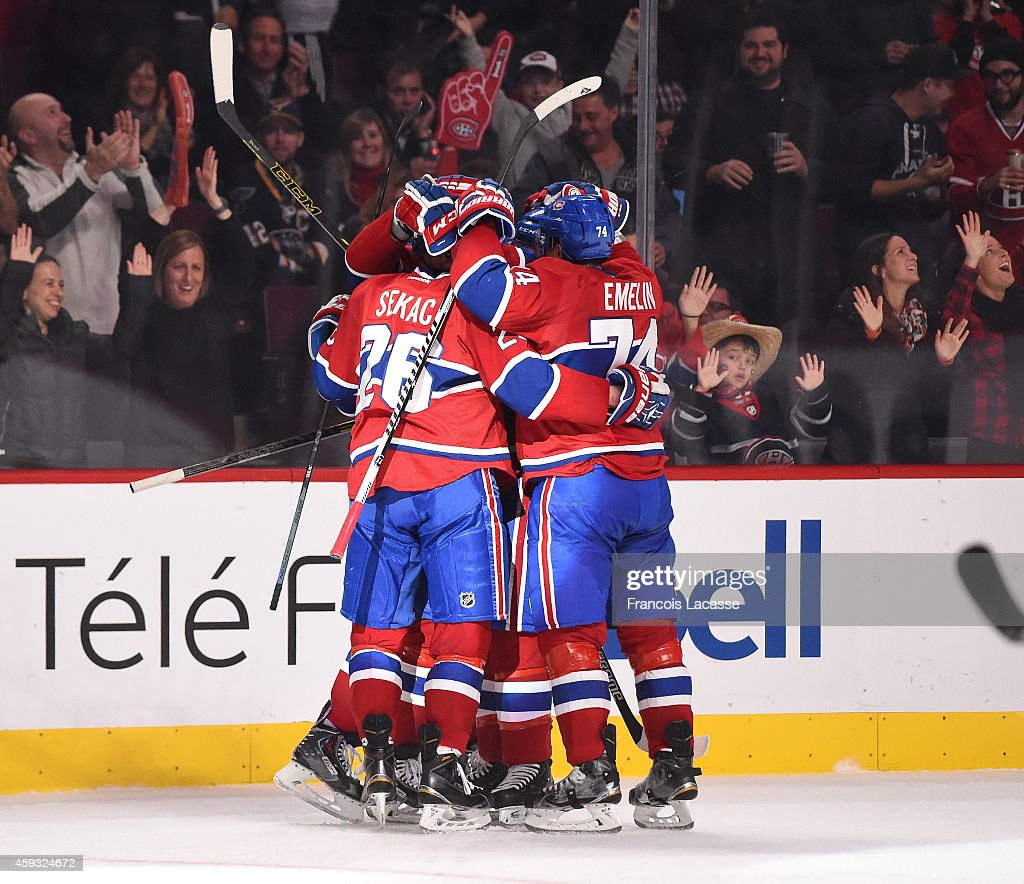 Lars Eller #81 of the Montreal Canadiens celebrates with teammates after scoring a goal against the St Louis Blues in the NHL game at the Bell Centre on November 20, 2014 in Montreal, Quebec, Canada.