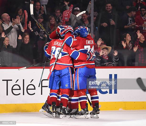 Lars Eller of the Montreal Canadiens celebrates with teammates after scoring a goal against the St Louis Blues in the NHL game at the Bell Centre on...