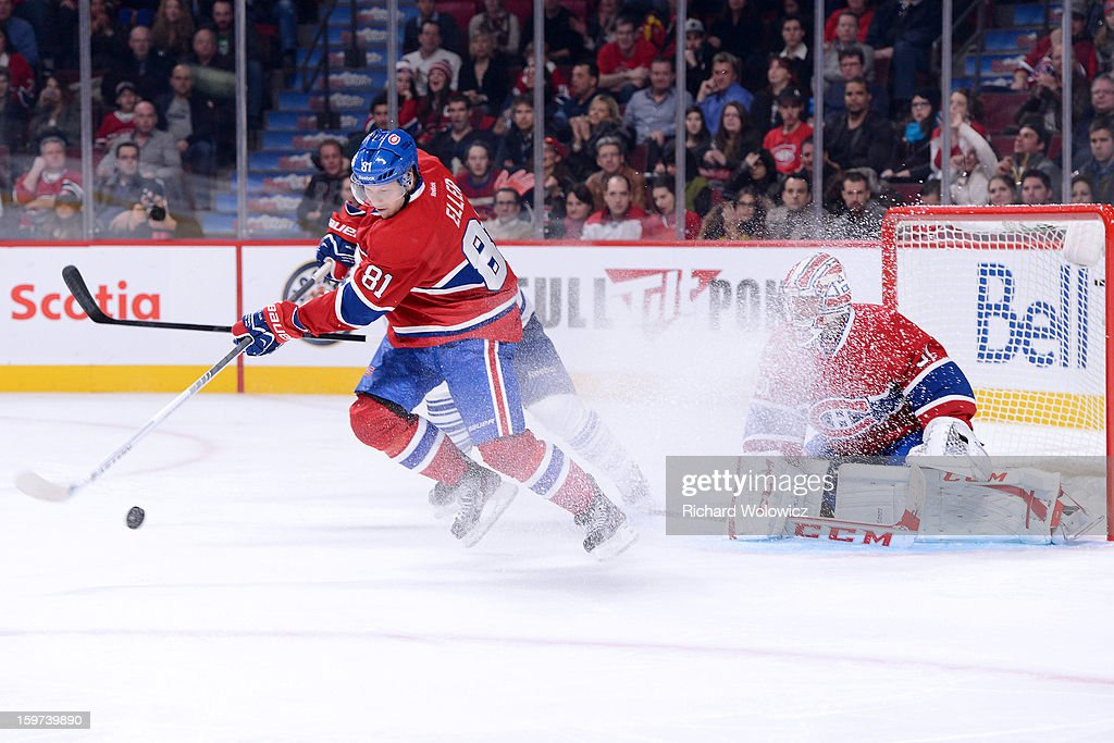 <a gi-track='captionPersonalityLinkClicked' href=/galleries/search?phrase=Lars+Eller&family=editorial&specificpeople=4324947 ng-click='$event.stopPropagation()'>Lars Eller</a> #81 of the Montreal Canadiens clears the posse puck from in front of teammate <a gi-track='captionPersonalityLinkClicked' href=/galleries/search?phrase=Carey+Price&family=editorial&specificpeople=2222083 ng-click='$event.stopPropagation()'>Carey Price</a> #31 during the NHL game against the Toronto Maple Leafs at the Bell Centre on January 19, 2013 in Montreal, Quebec, Canada. The Maple Leafs defeated the Canadiens 2-1.