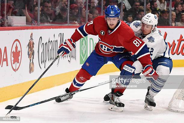 Lars Eller of the Montreal Canadiens controls the puck while being challenged by Tyler Bozak of the Toronto Maple Leafs in the NHL game at the Bell...