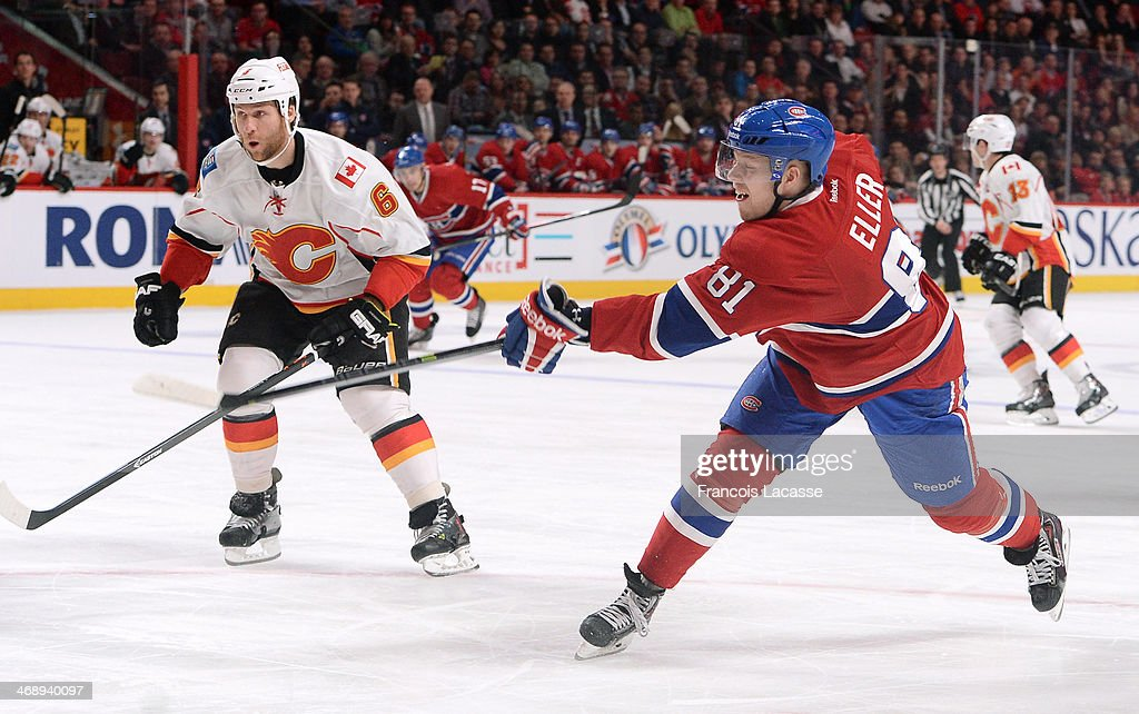 Lars Eller #8 of the Montreal Canadiens fires a slap shot against the Calgary Flames during the NHL game on February 4, 2014 at the Bell Centre in Montreal, Quebec, Canada.
