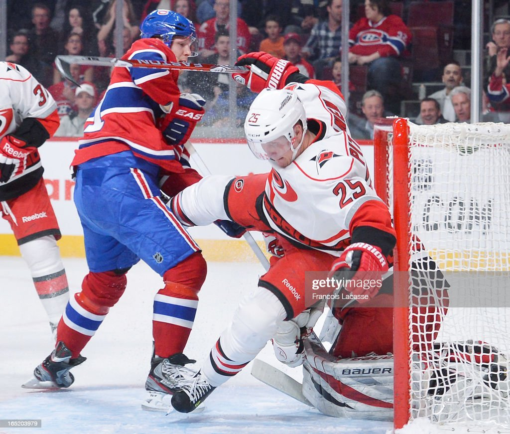 <a gi-track='captionPersonalityLinkClicked' href=/galleries/search?phrase=Lars+Eller&family=editorial&specificpeople=4324947 ng-click='$event.stopPropagation()'>Lars Eller</a> #81 of the Montreal Canadiens hits <a gi-track='captionPersonalityLinkClicked' href=/galleries/search?phrase=Joni+Pitkanen&family=editorial&specificpeople=204480 ng-click='$event.stopPropagation()'>Joni Pitkanen</a> #25 of the Carolina Hurricanes into his net during the NHL game on April 1, 2013 at the Bell Centre in Montreal, Quebec, Canada.