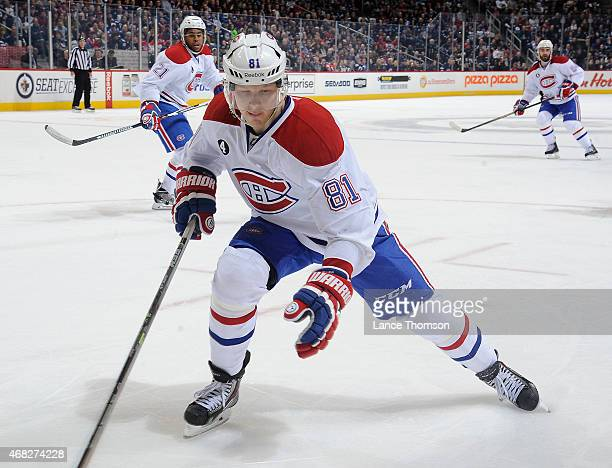 Lars Eller of the Montreal Canadiens keeps an eye on the play during third period action against the Winnipeg Jets on March 26 2015 at the MTS Centre...