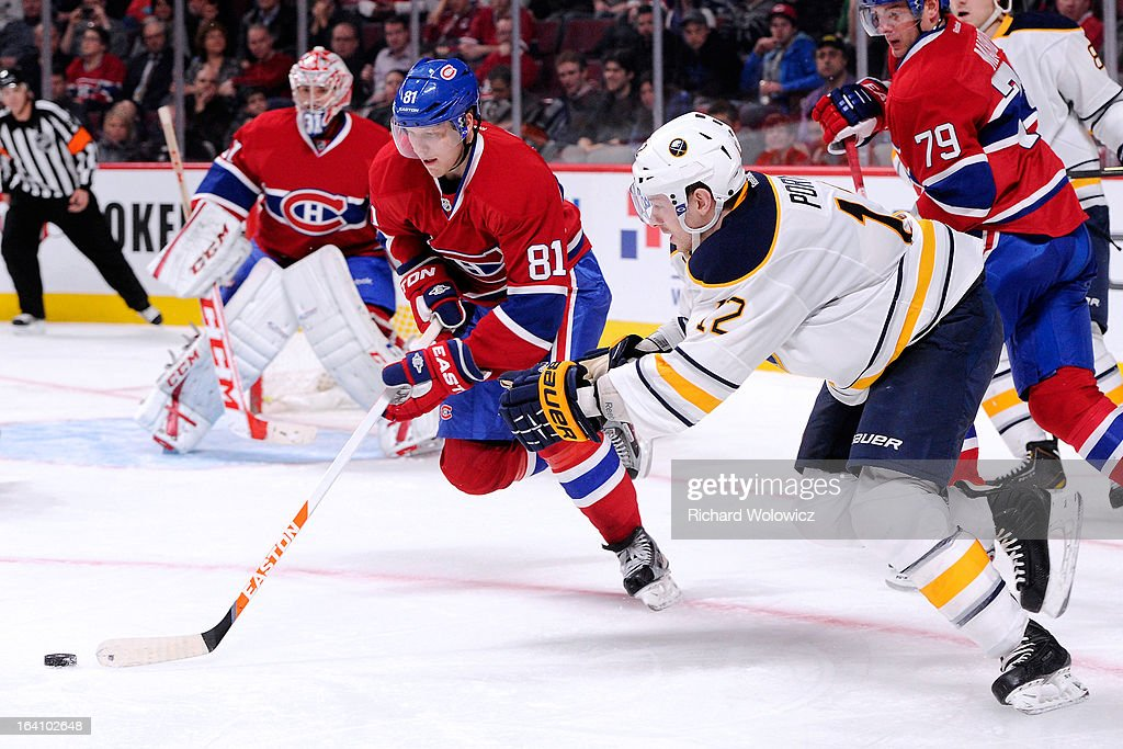 <a gi-track='captionPersonalityLinkClicked' href=/galleries/search?phrase=Lars+Eller&family=editorial&specificpeople=4324947 ng-click='$event.stopPropagation()'>Lars Eller</a> #81 of the Montreal Canadiens moves the puck past Kevin Porter #12 of the Buffalo Sabres during the NHL game at the Bell Centre on March 19, 2013 in Montreal, Quebec, Canada. The Sabres defeated the Canadiens 3-2 in overtime.