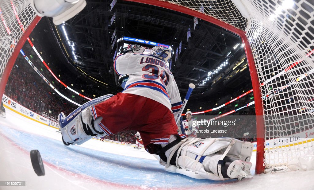 <a gi-track='captionPersonalityLinkClicked' href=/galleries/search?phrase=Lars+Eller&family=editorial&specificpeople=4324947 ng-click='$event.stopPropagation()'>Lars Eller</a> #81 of the Montreal Canadiens scores a goal on goaltender <a gi-track='captionPersonalityLinkClicked' href=/galleries/search?phrase=Henrik+Lundqvist&family=editorial&specificpeople=217958 ng-click='$event.stopPropagation()'>Henrik Lundqvist</a> #30 of the New York Rangers in Game One of the Eastern Conference Final during the 2014 Stanley Cup Playoffs at the Bell Centre on May 17, 2014 in Montreal, Quebec, Canada.