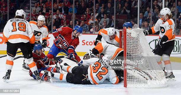 Lars Eller of the Montreal Canadiens shoots on goal while Mark Streit Scott Hartnell Braydon Coburn and Ray Emery of the Philadelphia Flyers protect...