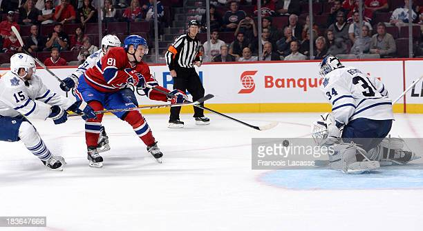 Lars Eller of the Montreal Canadiens shoots the puck past James Reimer of the Toronto Maple Leafs during the NHL game on October 1 2013 at the Bell...