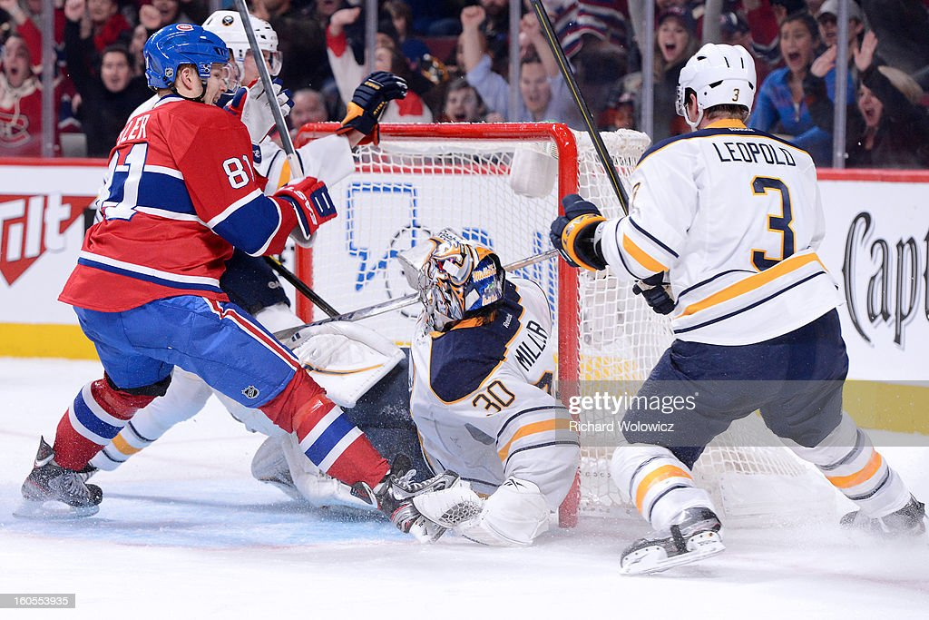 <a gi-track='captionPersonalityLinkClicked' href=/galleries/search?phrase=Lars+Eller&family=editorial&specificpeople=4324947 ng-click='$event.stopPropagation()'>Lars Eller</a> #81 of the Montreal Canadiens shoots the puck past Ryan Miller #30 of the Buffalo Sabres during the NHL game at the Bell Centre on February 2, 2013 in Montreal, Quebec, Canada. The Canadiens defeated the Sabres 6-1.