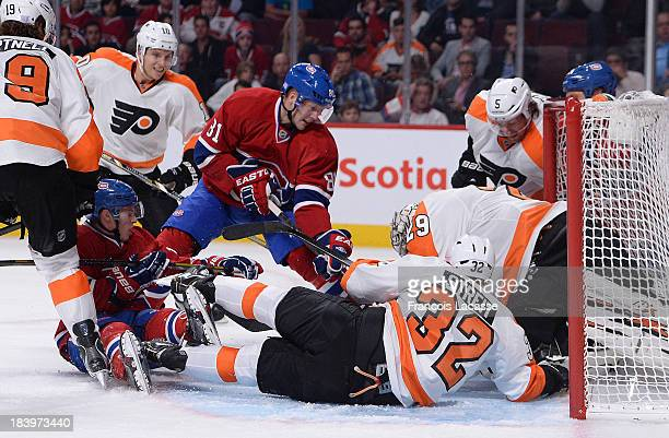 Lars Eller of the Montreal Canadiens shoots to the net while Mark Streit Scott Hartnell Braydon Coburn and Ray Emery of the Philadelphia Flyers...
