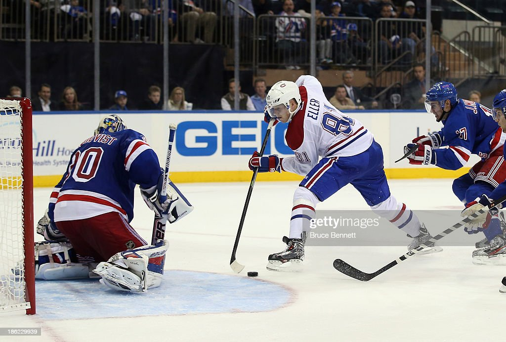 <a gi-track='captionPersonalityLinkClicked' href=/galleries/search?phrase=Lars+Eller&family=editorial&specificpeople=4324947 ng-click='$event.stopPropagation()'>Lars Eller</a> #81 of the Montreal Canadiens skates against <a gi-track='captionPersonalityLinkClicked' href=/galleries/search?phrase=Henrik+Lundqvist&family=editorial&specificpeople=217958 ng-click='$event.stopPropagation()'>Henrik Lundqvist</a> #30 of the New York Rangers at Madison Square Garden on October 28, 2013 in New York City. The Canadiens shutout the Rangers 2-0.