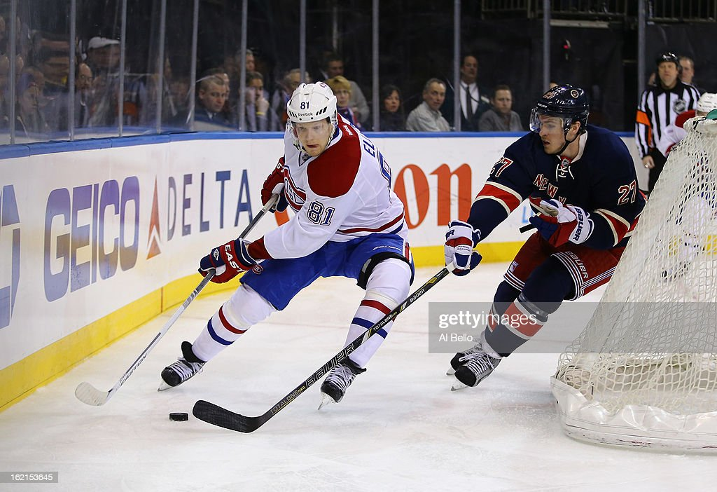 <a gi-track='captionPersonalityLinkClicked' href=/galleries/search?phrase=Lars+Eller&family=editorial&specificpeople=4324947 ng-click='$event.stopPropagation()'>Lars Eller</a> #81 of the Montreal Canadiens skates against <a gi-track='captionPersonalityLinkClicked' href=/galleries/search?phrase=Ryan+McDonagh&family=editorial&specificpeople=4324983 ng-click='$event.stopPropagation()'>Ryan McDonagh</a> #27 of the New York Rangers during their game at Madison Square Garden on February 19, 2013 in New York City.