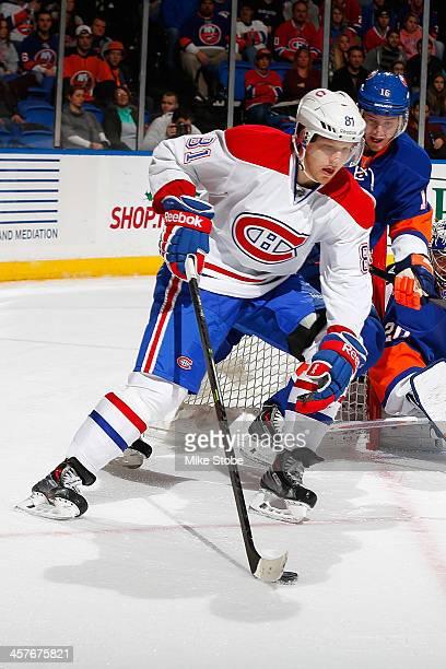 Lars Eller of the Montreal Canadiens skates against the New York Islanders at Nassau Veterans Memorial Coliseum on December 14 2013 in Uniondale New...
