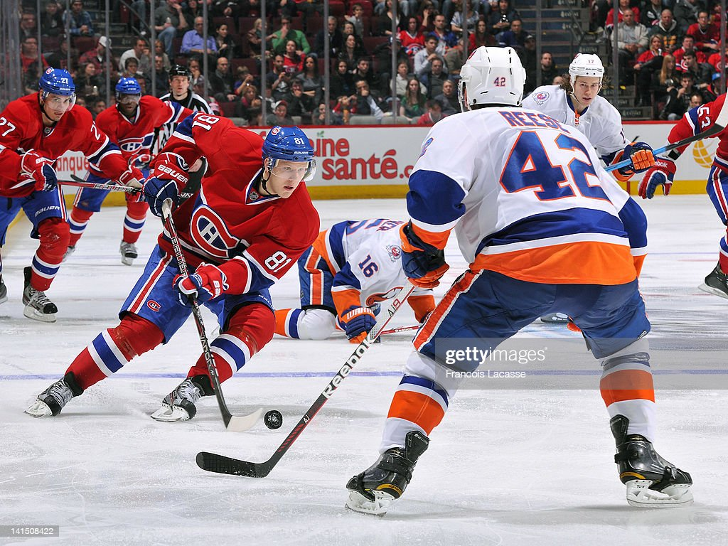 <a gi-track='captionPersonalityLinkClicked' href=/galleries/search?phrase=Lars+Eller&family=editorial&specificpeople=4324947 ng-click='$event.stopPropagation()'>Lars Eller</a> #81 of the Montreal Canadiens skates in on defenseman Dylan Reese #42 of the New York Islanders during the NHL game on March 17, 2012 at the Bell Centre in Montreal, Quebec, Canada.