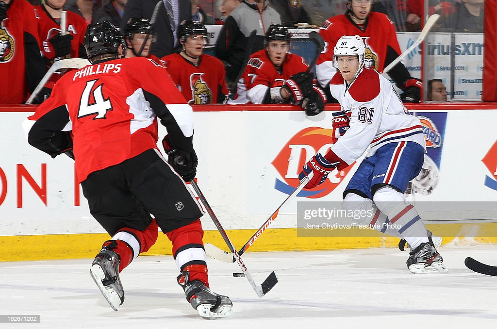 <a gi-track='captionPersonalityLinkClicked' href=/galleries/search?phrase=Lars+Eller&family=editorial&specificpeople=4324947 ng-click='$event.stopPropagation()'>Lars Eller</a> #81 of the Montreal Canadiens skates with the puck against Chris Phillips #4 of the Ottawa Senators, during an NHL game at Scotiabank Place on February 25, 2013 in Ottawa, Ontario, Canada.
