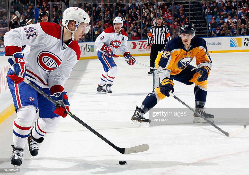 <a gi-track='captionPersonalityLinkClicked' href=/galleries/search?phrase=Lars+Eller&family=editorial&specificpeople=4324947 ng-click='$event.stopPropagation()'>Lars Eller</a> #81 of the Montreal Canadiens skates with the puck against <a gi-track='captionPersonalityLinkClicked' href=/galleries/search?phrase=Marcus+Foligno&family=editorial&specificpeople=5662790 ng-click='$event.stopPropagation()'>Marcus Foligno</a> #82 of the Buffalo Sabres at First Niagara Center on November 27, 2013 in Buffalo, New York. Montreal defeated Buffalo 3-1.