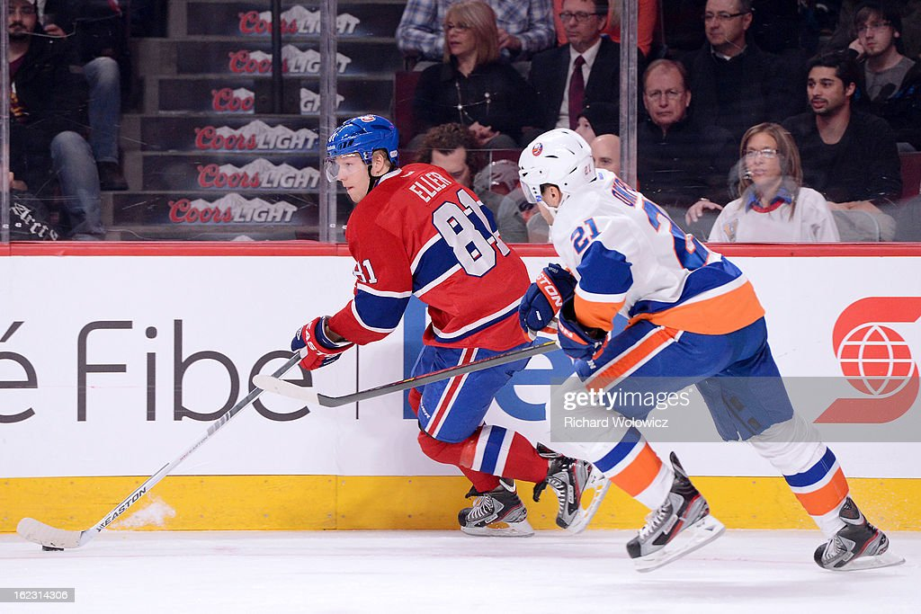 Lars Eller #81 of the Montreal Canadiens skates with the puck while being chased by Kyle Okposo #21 of the New York Islanders during the NHL game at the Bell Centre on February 21, 2013 in Montreal, Quebec, Canada.